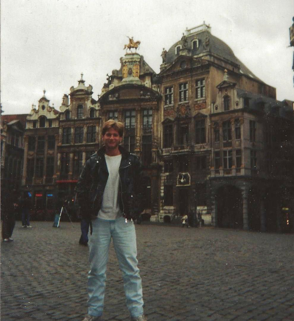 """Traveling in Europe after father's death. Brussels Belgium - Standing in LE GRAND PLACE...Drank my first """"fruit"""" flavored beer here."""